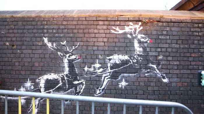 Outrage after new Banksy Christmas graffiti is defaced just HOURS after it pops up on a wall in Birmingham