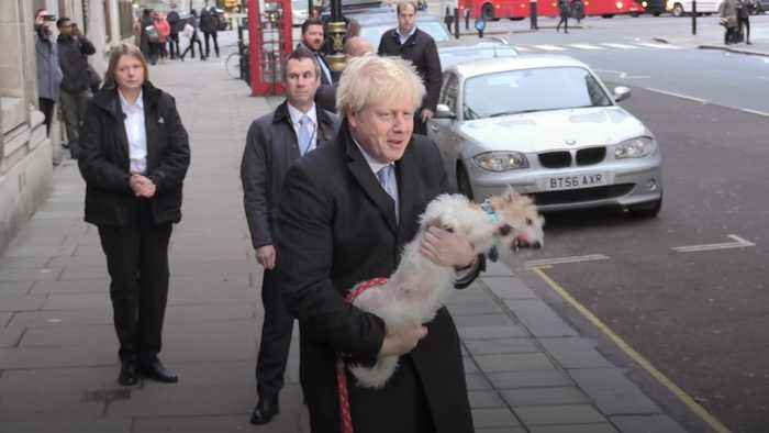 Boris Johnson arrives with his dog Dilyn to cast General Election vote