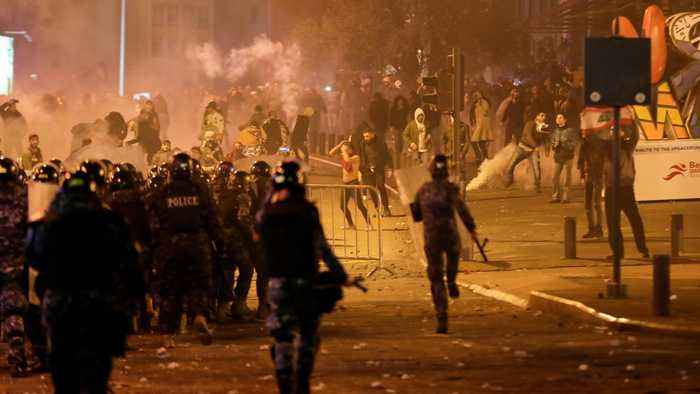 Street battles in Beirut as counterprotesters clash with police