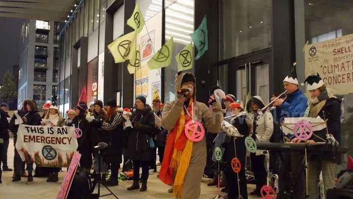 Eco-themed Christmas carols sung by climate activists outside Shell's London HQ