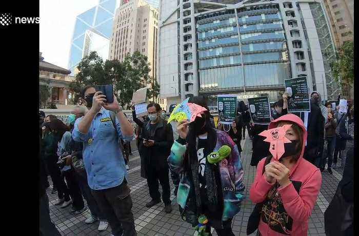 Demonstrators sing 'Glory to Hong Kong' during peaceful protest