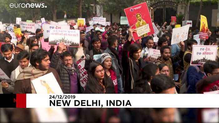 Hundreds march in New Delhi against citizenship law that excludes Muslims