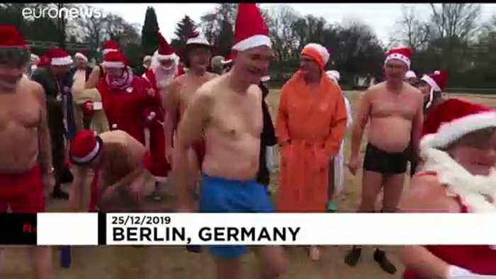Berlin swimmers take the plunge for Christmas