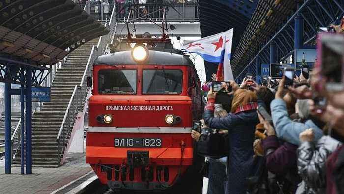 Ukraine opens probe into Russian train on new bridge to Crimea
