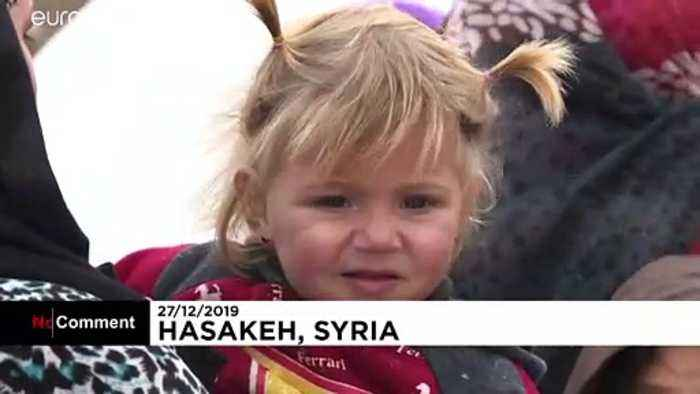 Activists distribute Christmas presents at camp for displaced Syrian children
