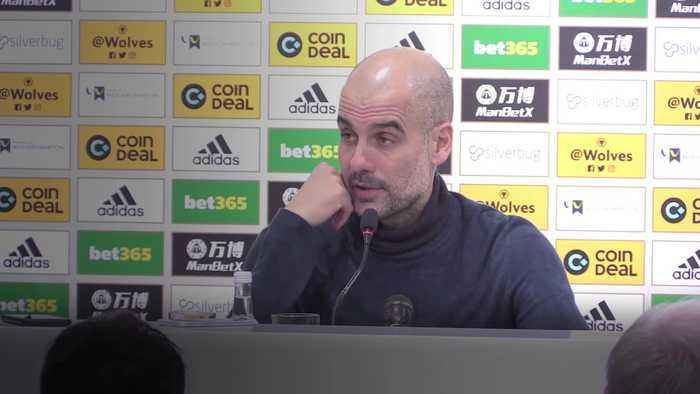 Guardiola focusing on second place after City lose at Wolves