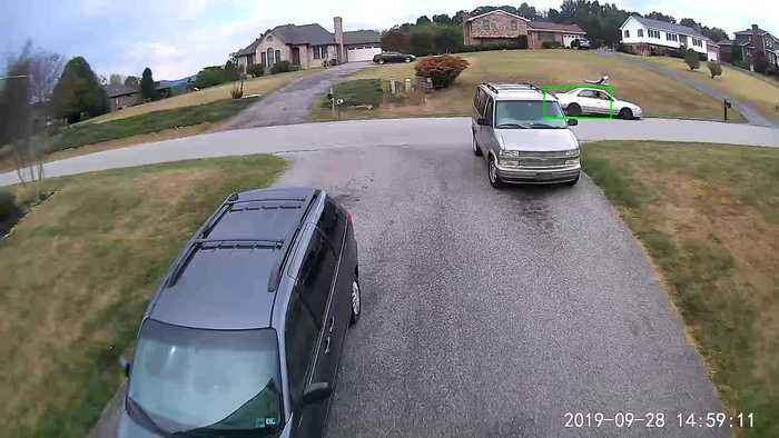 Driver Takes Out Mailbox