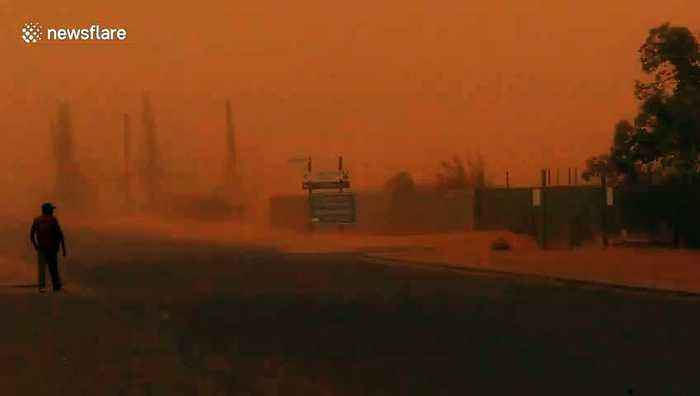 Dust storm hits Australian outback before heading towards fire-ravaged states
