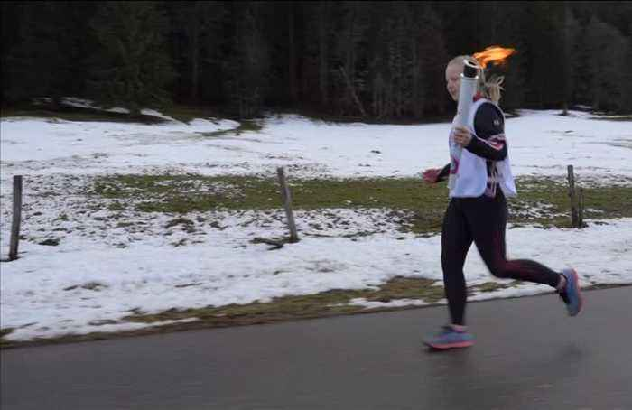 Olympic flame crosses Swiss-French border