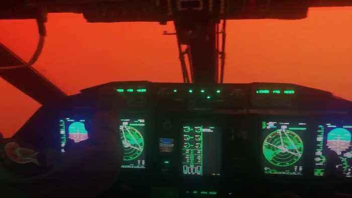 Australian Air Force plane flight through red smoke from bushfires