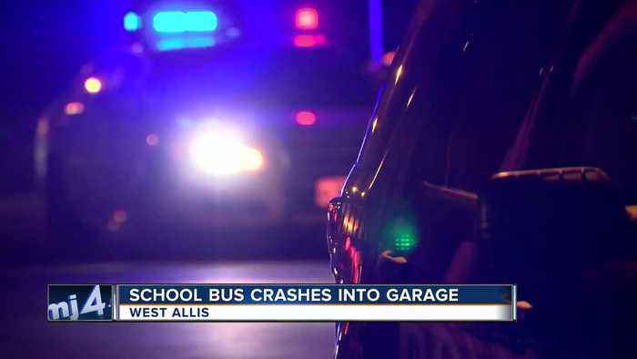 School bus with children on board crashes into a West Allis garage
