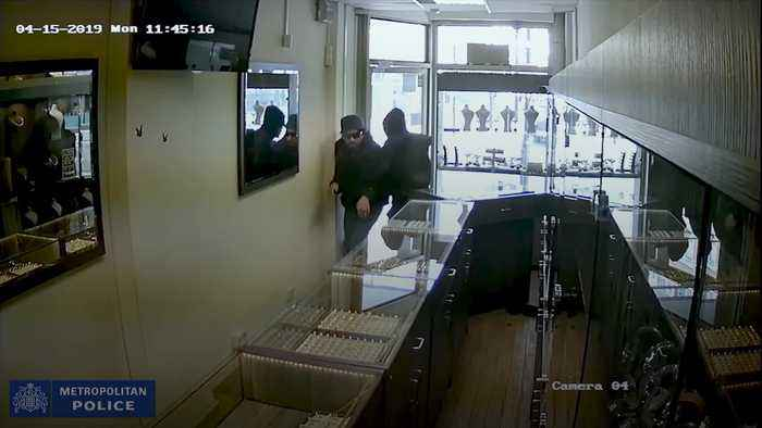 Bungling robber locked in shop during raid