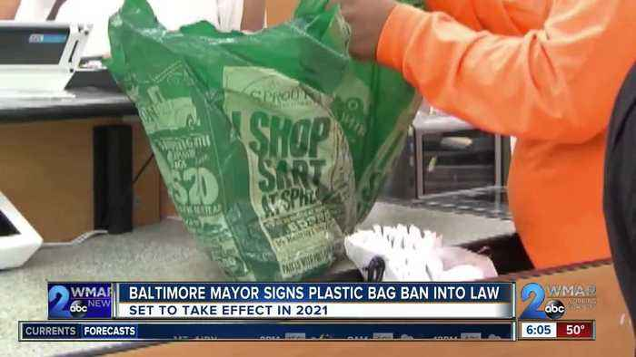 Young signs Baltimore's plastic bag ban into law