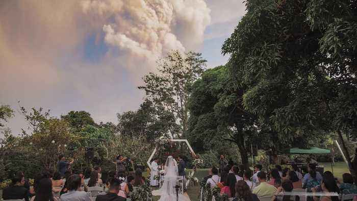 Wedding goes ahead despite erupting volcano
