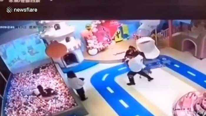 Chinese father throws four-year-old across floor after arguing with son over toys
