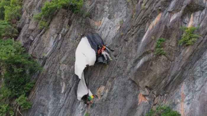 This is the Heartstopping Rescue of a Base Jumper Stuck on the Side of a Cliff