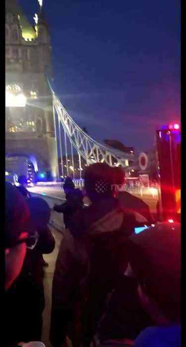 Police on scene as man slides down London's famed Tower Bridge