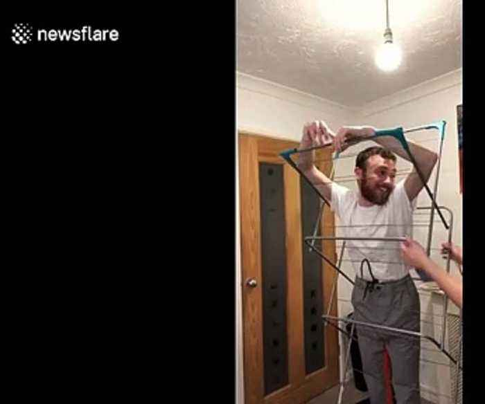 Hilarious moment man gets stuck in clothing rack in hilarious TikTok gone wrong