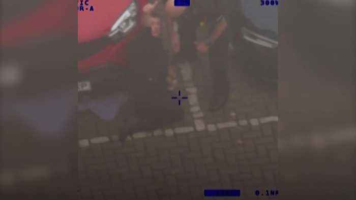 Man tries to hide from police by crawling under car