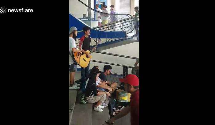 Schoolchildren perform outside shopping mall to raise money for Taal volcano victims