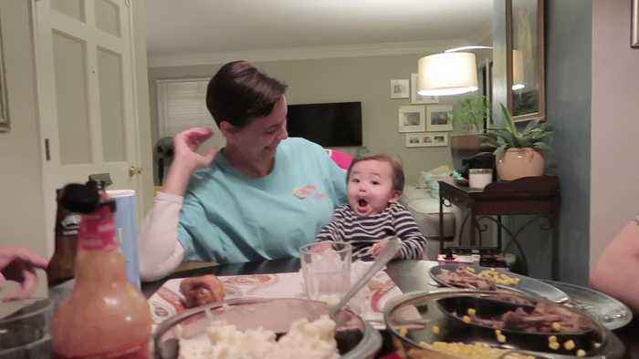 Baby Makes Funny Faces While Sitting at Dinner Table Making Everyone Laugh Out Hard