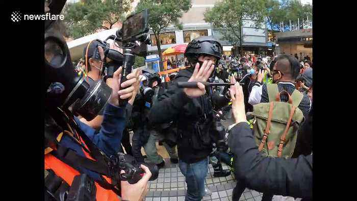 Scuffles break out between protesters and riot police in central Hong Kong