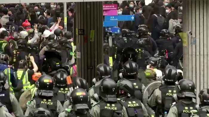 Police fire tear gas as thousands rally in Hong Kong