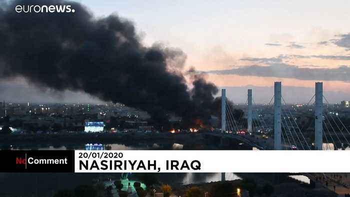 Iraqi security forces and anti-government protesters clash in Baghdad
