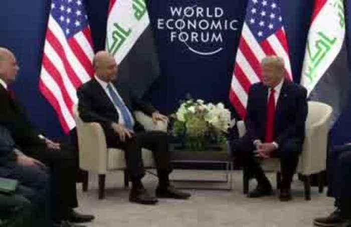 Trump meets Iraqi president in Davos