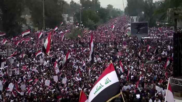 """""""No to America"""": Thousands of Iraqis rally against U.S. military presence"""