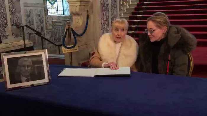 Sharon Stone signs Seamus Mallon book of condolence