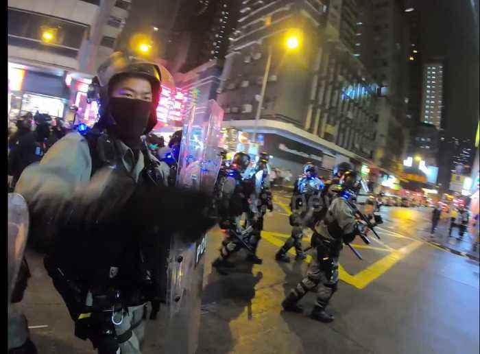 Riot police clear streets as crowd gathers to mark 4th anniversary of Mong Kok riots
