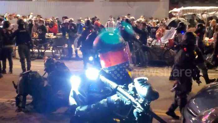 Tension in Hong Kong as riot police make arrests storming street food market