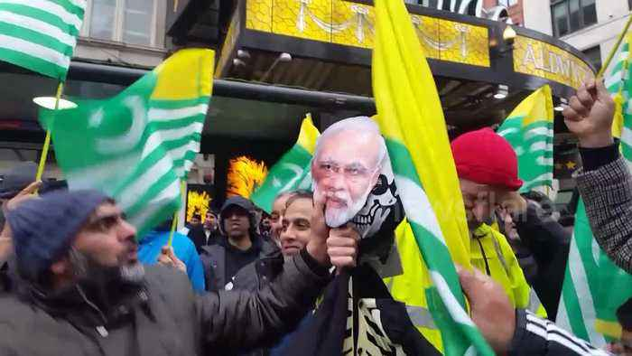 Kashmir solidarity demonstration sees protesters hit Modi mask with shoe
