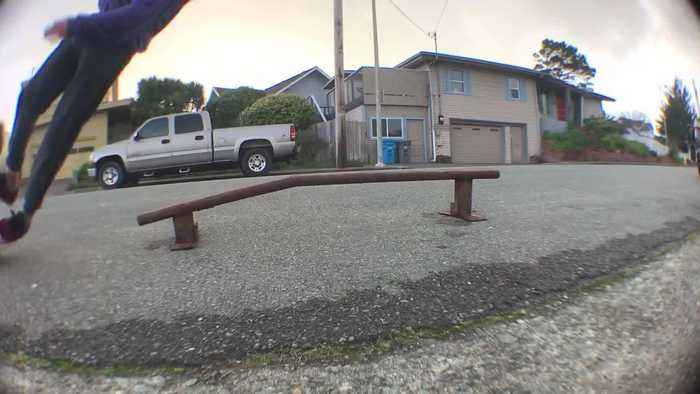 Boy Loses Balance While Skateboarding on Metal Pipe and Falls on Ground