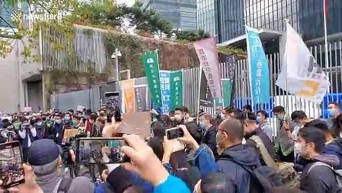 Health workers protest outside government offices in Hong Kong over deadly coronavirus