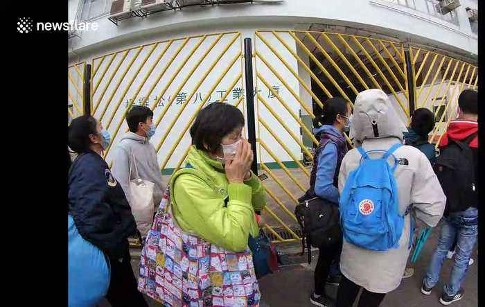 Hongkongers camp overnight and queue around the block in race to buy face masks