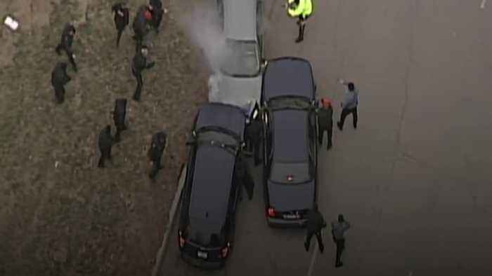 Police chase car on parade route for Super Bowl winners in Kansas City