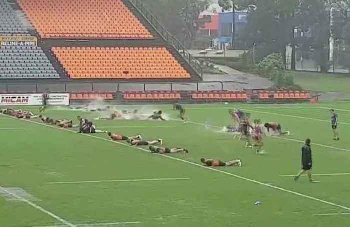 Rugby players slip and slide as heavy rain hits Australia