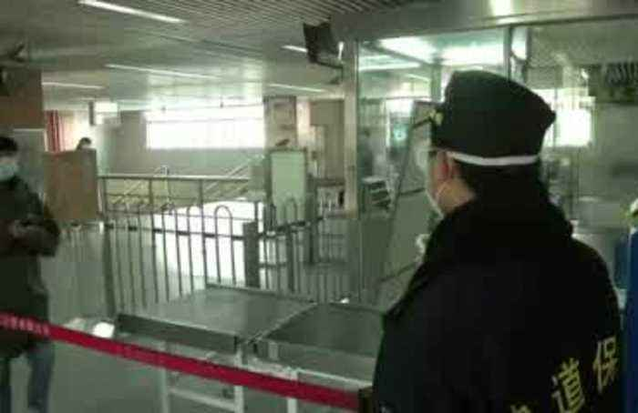 China returns to work as virus hits daily record