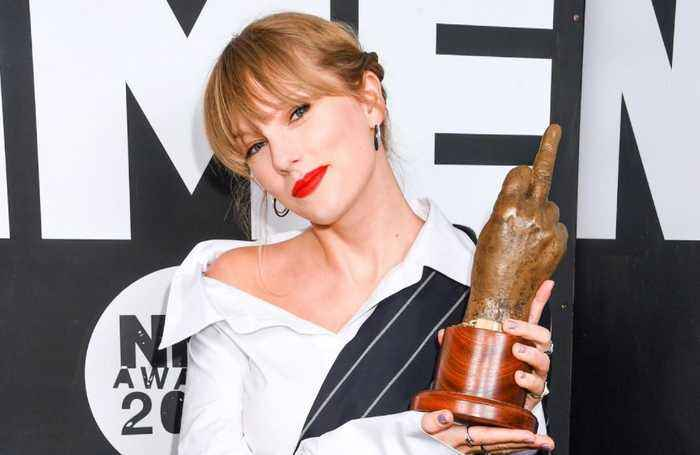 Taylor Swift makes surprise appearance to accept NME Award