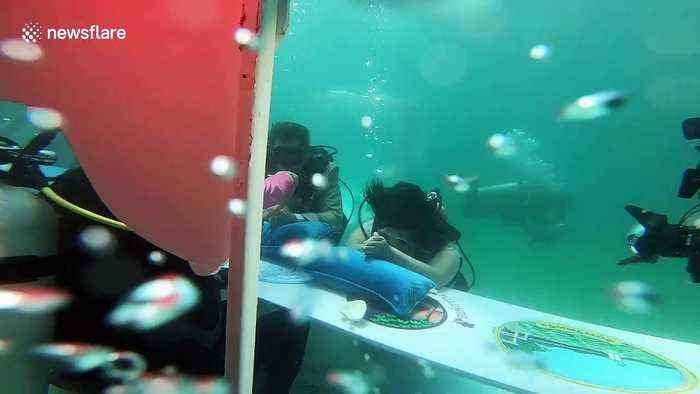 Thai couple get married in underwater ceremony for Valentine's Day