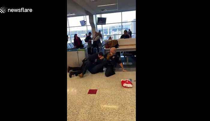 'On another planet': Shocking scene as man is tased by police at Dallas airport