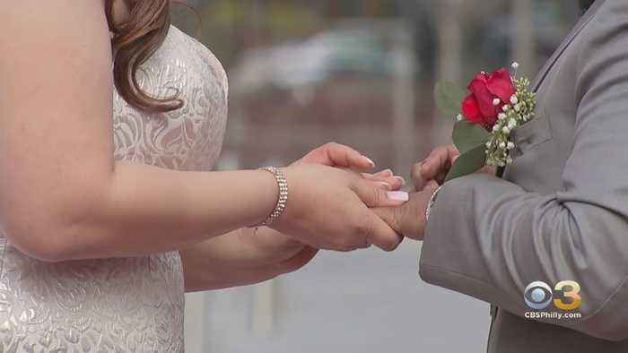 Couples Brave Cold, Windy Weather To Tie The Knot At Love Park On Valentine's Day