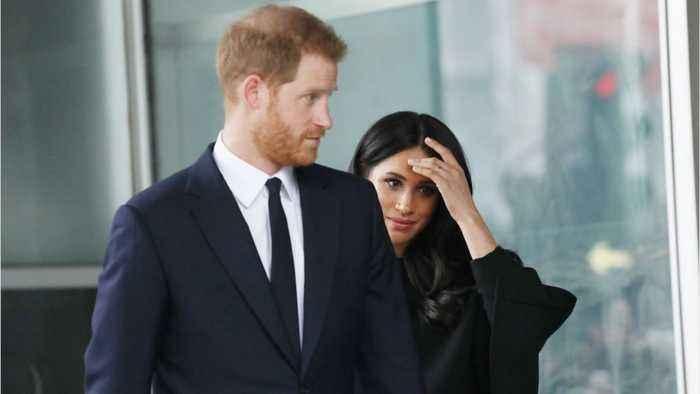 Prince Harry and Meghan Close Buckingham Palace Office