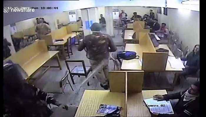 Shocking moment Indian police attack university students inside library