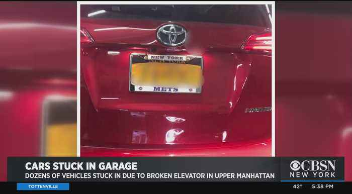 Exclusive: More Than 2 Dozen Cars Trapped In Parking Garage