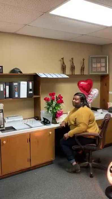 Man Surprises Wife in Office With Gift and Saxophone Performance on Valentine's Day