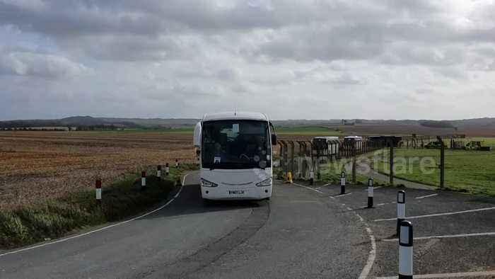 Coronavirus: Diamond Princess passengers leave Boscombe Down on coaches