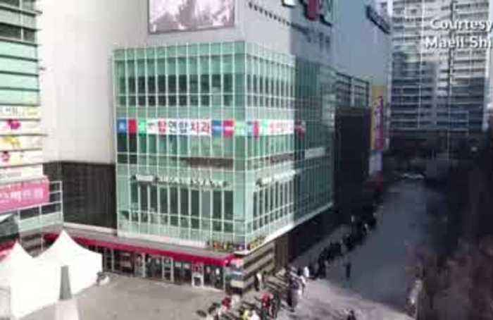 Drone video shows long lines for masks in South Korea's Daegu